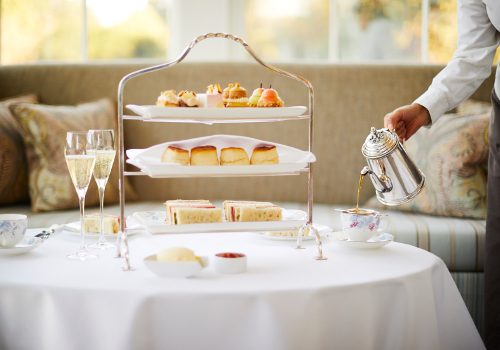 Main 2 Afternoon Tea at Coworth Park in the Drawing Room Tea Pouring